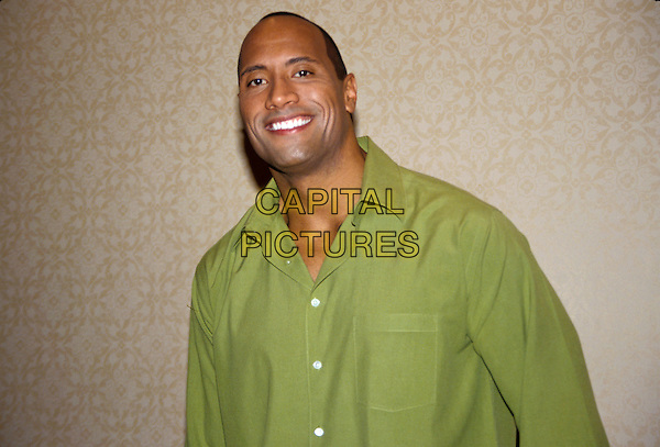 THE ROCK - DWAYNE JOHNSON.March 2005.half length green shirt  .www.capitalpictures.com.sales@capitalpictures.com.© Capital Pictures.