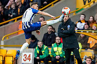 7th March 2020; Molineux Stadium, Wolverhampton, West Midlands, England; English Premier League, Wolverhampton Wanderers versus Brighton and Hove Albion; Solly March of Brighton & Hove Albion tries to reach and stop the ball from going out of play