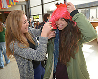NWA Democrat-Gazette/ANDY SHUPE<br /> Friends Addie Quinn (left) and Rita Dominguez, both freshman at the University of Arkansas from Austin, Texas, laugh Wednesday, Feb. 7, 2018, while dressing up before taking photographs at a photo booth set up during University Programs' UP Day in the Arkansas Union on the university campus in Fayetteville. The event gives members of the campus community a chance to learn about University Programs and how to become more involved on campus.