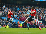 Raheem Sterling of Manchester City has a shot blocked by Luis Antonio Valencia of Manchester United during the premier league match at the Etihad Stadium, Manchester. Picture date 7th April 2018. Picture credit should read: Simon Bellis/Sportimage