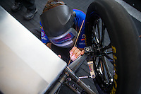 May 17, 2015; Commerce, GA, USA; NHRA top fuel driver Richie Crampton does some welding work to the chassis of his dragster during the Southern Nationals at Atlanta Dragway. Mandatory Credit: Mark J. Rebilas-USA TODAY Sports