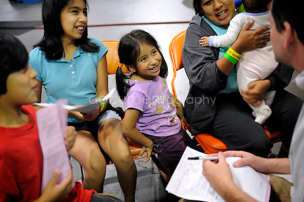 Connie, from Santa Monica, and her four children (Joel, 9, Salama, 11, Paola, 5 and Ariana, 6 month old) come to the RAM program in order to get the children checked up by Alexander, a paediatrician who volunteers for the week. Connie, a house wife, cannnot remember the last time she went for a check up and since she hasn't been to the dentist since she was a girl. It is too expensive for her...copyright : Magali Corouge/Documentography..August 2009, Los Angeles, USA...