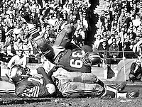 San Francisco 49ers #39 Kermit Alexander upended, #22 Vic Washington. <br />