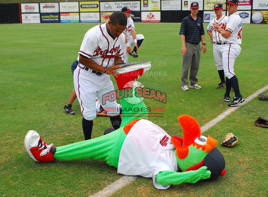 July 15, 2009: L.V. Ware (7) of the Danville Braves pretends to help Braves mascot Blooper stretch before a game against the Elizabethton Twins at Dan Daniel Memorial Park in Danville, Va. Photo by:  Tom Priddy/Four Seam Images