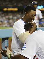 September 24, 2014 Los Angeles, CA: Los Angeles Dodgers second baseman Dee Gordon #9 and right fielder Yasiel Puig #66 during an MLB game between the San Francisco Giants and the Los Angeles Dodgers played at Dodger Stadium The Dodgers defeated the Giants 9-1 to win the National League West Title.