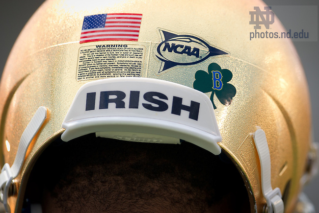 """Apr. 20, 2013; The Irish wore shamrock stickers with the letter """"B"""" in honor of the victims of the Boston Marathon bombing...Photo by Matt Cashore/University of Notre Dame"""