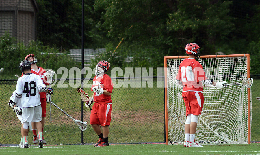 Lenape goaltender Manny D'Alessio (C) reacts after allowing a 13th goal during the Group 4 state championship game at Hopewell Valley Central High School Thursday May 28, 2015 in Hopewell, New Jersey. Lenape lost to Bridgewater 16-8. (Photo by William Thomas Cain/Cain Images)