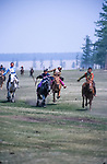 Horseracing bareback at the Naadam festival.    Northern outer Mongolia<br /> <br /> The games are Mongolian wrestling, horse racing, and archery, and are held throughout the country during midsummer. Women have started participating in the archery and girls in the horse-racing games, but not in Mongolian wrestling.