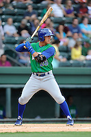 First baseman Mark Threlkeld (26) of the Lexington Legends bats in a game against the Greenville Drive on Friday, August 18, 2013, at Fluor Field at the West End in Greenville, South Carolina. Lexington won, 5-0. (Tom Priddy/Four Seam Images)