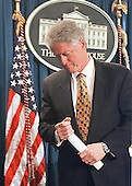 United States President Bill Clinton is visibly upset as he leaves the White House Press Briefing Room in Washington, DC after delivering his statement on the shootings in Littleton, Colorado on 20 April, 1999.<br /> Credit: Ron Sachs / CNP