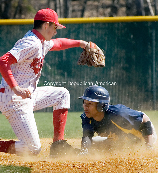 WATERBURY, CT. 07 April 2012-040712SV07-#22 Tim Bergin of Wamogo High tags out #23 Angel Torres of Kennedy High at second during baseball action at Municipal Stadium in Waterbury Saturday..Steven Valenti Republican-American