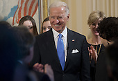 United States Vice President Joe Biden arrives to take the oath of office during the 57th Presidential Inauguration official swearing-in ceremony at the Naval Observatory on January 20, 2013 in Washington, DC. The oath is administered by US Supreme Court Justice Sonia Sotomayor.   .Credit: Saul Loeb / Pool via CNP