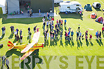 Close shave for the photographer as he watches thye crowd wave up at him at the Air Display Show on Sunday in Ardfert.........