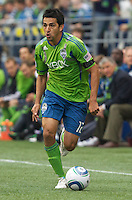 Seattle Sounders FC defender Leonardo Gonzalez  dribbles the ball during play against the New York Red Bulls at Qwest Field in Seattle Saturday June 23, 2011. The Sounders won the game 4-2.