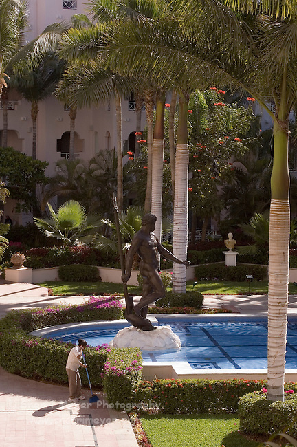 Worker cleans near the reflecting pool, Pueblo Bonito Rose' Resort, Cabo San Lucas, Baja California, Mexico