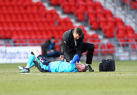 Kevin O'Connor of Fleetwood Town receiving treatment during the Sky Bet League 1 match between Doncaster Rovers and Fleetwood Town at the Keepmoat Stadium, Doncaster, England on 17 February 2018. Photo by Leila Coker / PRiME Media Images.