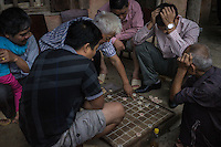 September 19, 2014 - Don Vang (Vietnam). Locals play checkers outside a house in the center of Don Vang. © Thomas Cristofoletti / Ruom