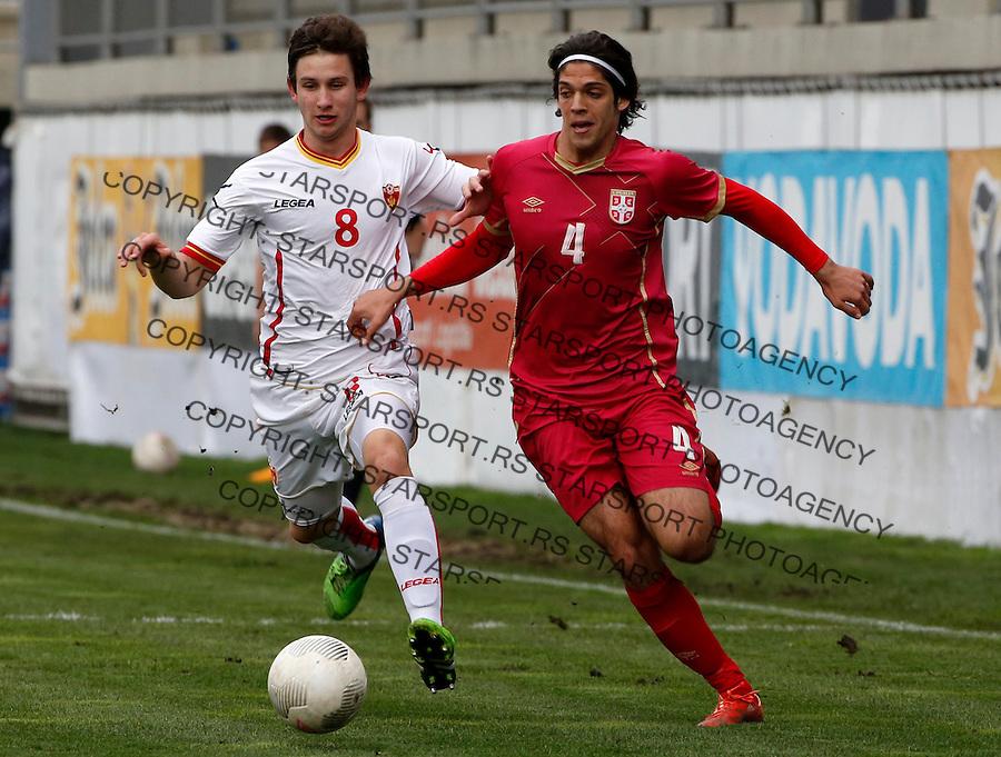 Fudbalski Savez Srbije<br /> Elite round - Group 7<br /> Srbija U19 v Crna Gora U19<br /> Lazar Zlicic (R) and Danilo Markovic<br /> Gornji Milanovac, 26.03.2016.<br /> foto: Srdjan Stevanovic/Starsportphoto &copy;