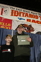 Thursday March 2, 2006  Anchorage, Alaska   Young KJ Peck poses with musher and author Gary Paulsen at the musher's pre-race drawing and banquet after KJ chose Paulsen's name from a random drawing sponsored by Cabela's.