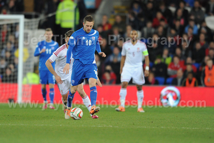 Emyr Huws of Wales(hidden) is about to challenge Gylfi Thor Sigurosson of Iceland and Tottenham Hotspurs. Cardiff City Stadium, Cardiff, Wales, Wednesday 5th March 2014. The Football Association of Wales - Vauxhall International Friendly - Wales v Iceland. Pictures by Jeff Thomas Photography - www.jaypics.photoshelter.com - Contact: thomastwotimes@live.co.uk - 07837 386244