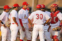 Johnson City Cardinals manager Joe Almaraz (30) talks with his starting pitcher Carlos Gonzalez (18) (center) and the entire infield at Howard Johnson Field in Johnson City, TN, Thursday July 3, 2008.
