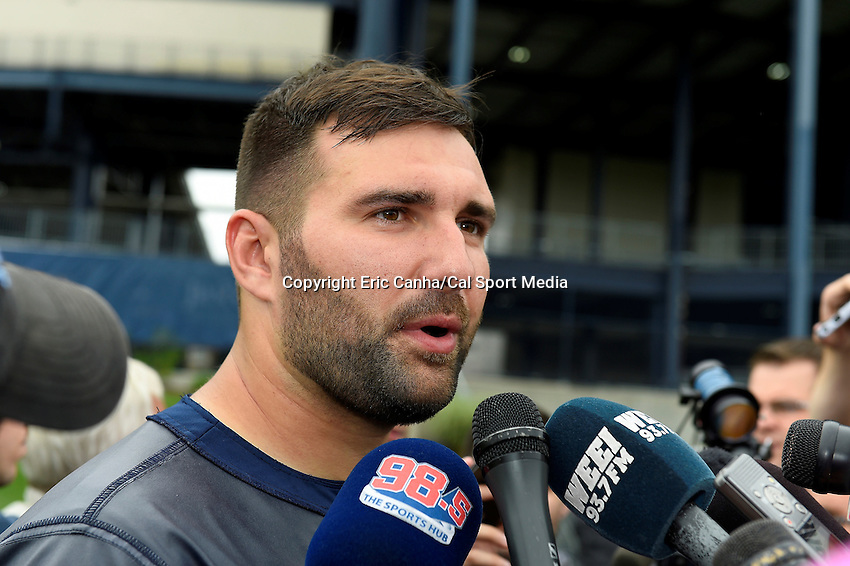 June 12, 2014 - Foxborough, Massachusetts, U.S. - New England Patriots defensive end Rob Ninkovich (50)   takes questions from the media at the team's organized team activity at Gillette Stadium in Foxborough, Massachusetts. Eric Canha/CSM