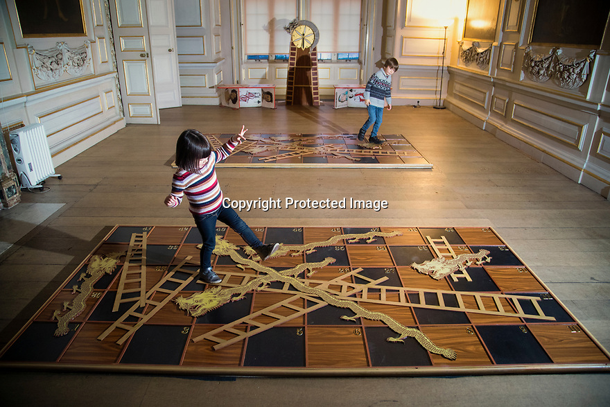 21/11/19<br /> <br /> Edward Johnstone (6) plays Snakes and Ladders with his sister Martha (4) in the Saloon.<br /> <br /> Game On: A supersized snakes and ladder and other board games feature at the National Trust's Sudbury Hall, Derbyshire, where rooms have been converted into board games for Christmas. Visitors themselves are the playing pieces on the snakes and ladders board while other traditional board games featured include Scrabble, Guess Who and Cluedo.<br /> <br /> Full story:  https://rkp-press-releases.netlify.com/press-releases/2019-11-20-sudbury-hall-christmas-game-on-national-trust/<br /> <br /> <br /> All Rights Reserved: F Stop Press Ltd.  <br /> +44 (0)7765 242650 www.fstoppress.com