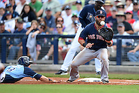 Boston Red Sox first baseman Mike Napoli (12) takes a throw as Ben Zobrist (18) dives back to first during a spring training game against the Tampa Bay Rays on March 25, 2014 at Charlotte Sports Park in Port Charlotte, Florida.  Boston defeated Tampa Bay 4-2.  (Mike Janes/Four Seam Images)