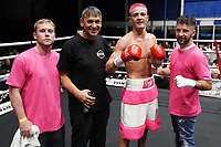 Anton Haskins (pink shorts) defeats Ibrar Riyaz during a Boxing Show at Whitchurch Leisure Centre on 5th October 2019. Lee Haskins and his son Anton Haskins both appeared on the same card, Anton making his professional debut.