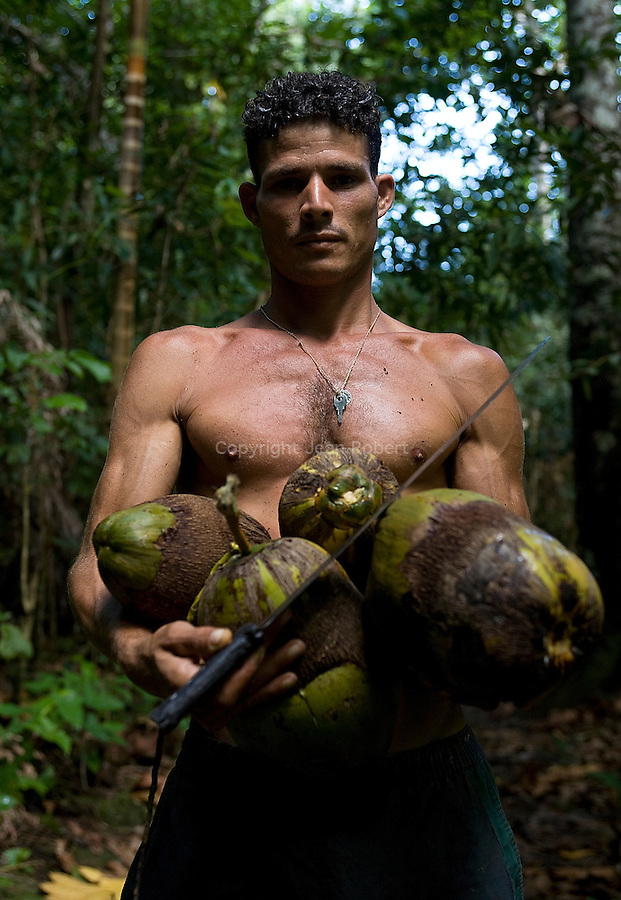 Man with coconuts. Canyon of Boca de Yumuri east of Baracoa