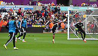 Wednesday, 23 April 2014<br /> Pictured: Wayne Routledge (C) goes for goal against Michel Vorm (R).<br /> Re: Swansea City FC are holding an open training session for their supporters at the Liberty Stadium, south Wales,