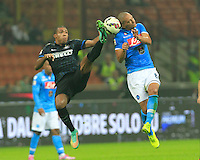 Juan Jesus  znd  Gokhan Inler  during the Italian serie A   soccer match between SSC Napoli and Inter    at  the San Siro    stadium in Milan  Italy , Octoberr 19 , 2014
