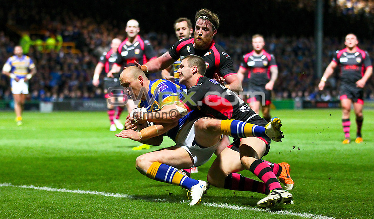 Picture by Alex Whitehead/SWpix.com - 11/04/2014 - Rugby League - First Utility Super League - Leeds Rhinos v Wakefield Wildcats - Headingley Stadium, Leeds, England - Leeds' Carl Ablett scores a try despite the best efforts of Wakefield's Luke Briscoe.
