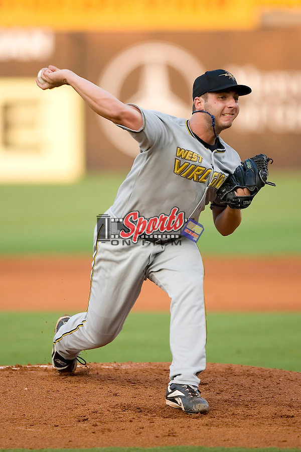 West Virginia Power starting pitcher Will Inman winds up to deliver the ball to the plate versus the Greensboro Grasshoppers at First Horizon Park in Greensboro, NC, Wednesday, August 23, 2006.
