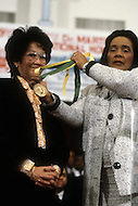 Atlanta, Georgia, U.S.A, 15 January, 1987. The 58th birthday memorial of Martin Luther King. Coretta King offering the Martin Luther King award to sister of  Cory Aquino, the president of Philippines.