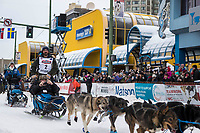 Cody Strathe and team leave the ceremonial start line with an Iditarider and handler at 4th Avenue and D street in downtown Anchorage, Alaska on Saturday March 3rd during the 2018 Iditarod race. Photo ©2018 by Brendan Smith/SchultzPhoto.com