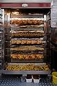 Paris, France. 09.05.2015. Chicken on Rotisserie, Rue Mouffetarde, Paris France. Photograph © Jane Hobson.
