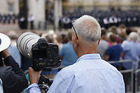 photographer with Kim Jong Un style haircut<br /> RAF centenary fly-past at Buckingham Palace, The Mall, London England on July 10, 2018.<br /> CAP/PL<br /> &copy;Phil Loftus/Capital Pictures