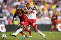 Thierry Henry (14) of the New York Red Bulls is marked by Aaron Maund (4) of Real Salt Lake. The New York Red Bulls defeated Real Salt Lake 4-3 during a Major League Soccer (MLS) match at Red Bull Arena in Harrison, NJ, on July 27, 2013.