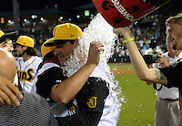 Jacksonville Suns manager Andy Barkett (17) gets the water bucket dumped over his head by starting pitcher Justin Nicolino (22) after clinching Southern League Championship Series against the Chattanooga Lookouts on September 12, 2014 at Bragan Field in Jacksonville, Florida.  Jacksonville defeated Chattanooga 6-1 to sweep three games to none.  (Mike Janes/Four Seam Images)