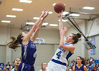 NWA Democrat-Gazette/BEN GOFF @NWABENGOFF<br /> Audra Unruh (left) of Fayetteville guards as Madison Loyd of Rogers makes a basket Friday, Feb. 9, 2018, in King Arena at Rogers High.