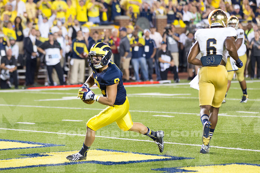 """The University of Michigan football team beat Notre Dame, 41-30, in the """"Under the Lights II"""" game at Michigan Stadium in Ann Arbor, Mich., on September 7, 2013."""