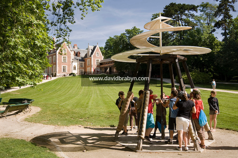 Children play with a replica of Leonardo da Vinci's propeller prototype on display in the gardens of the Clos Luce mansion, the inventor's last home, in Amboise, France, 26 June 2008.