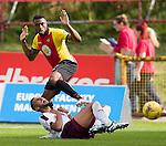 Faycal Rherras takes a sore one from David Amoo