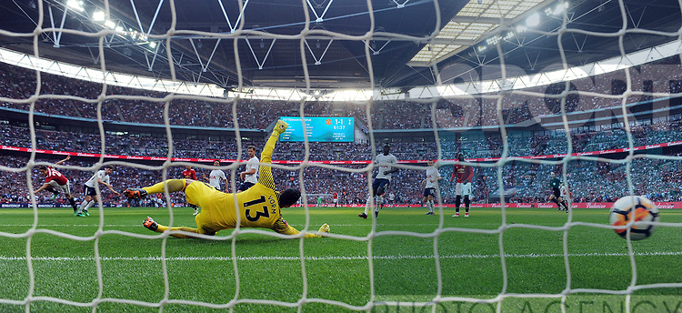 Ander Herrera of Manchester United scores his goal to make it 2-1 past Tottenham Hotspur goalkeeper Michel Vorm during the FA cup semi-final match at Wembley Stadium, London. Picture date 21st April, 2018. Picture credit should read: Robin Parker/Sportimage