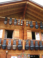 Cow bells adorn an alpine farmhouse