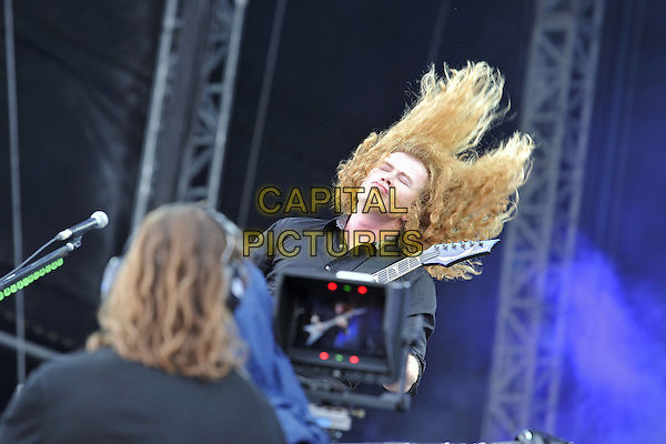 Dave Mustaine of Megadeath .Performing live during Day 1 of Sonisphere festival, Knebworth House, England, UK, 8th July 2011..music live on stage gig concert half length black  shirt playing guitar hair funny eyes shut .CAP/MAR.© Martin Harris/Capital Pictures.