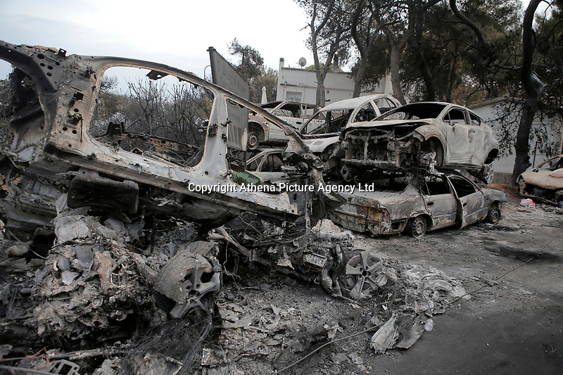 Pictured: Piles of destroyed cars in the aftermath of the forest fire which has claimed dozens of lives in the Mati area of Rafina, Greece. Tuesday 24 July 2018<br /> Re: Deaths caused by wild forest fires throughout Greece.