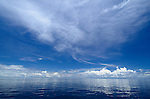 A flat calm sea with reflecting clouds, Raja Ampat, Indonesia, Pacific Ocean