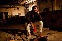 Minister of Legislative Assembly, Ritesh Pandey, 30, unwinds as he sits around a fire in his father's cowshed at home after campaigning late into the night in Jalalpur constituency in Uttar Pradesh, India, on 20th January, 2012. Returning 1.5 years ago after almost 10 years abroad, Pandey is contesting on behalf of the Bahujan Samaj Party (BSP), a party that is based on its appeal to Dalit (the lowest Hindu caste) voters. Party leader, Mayawati herself is a Dalit but has recently been giving out more tickets to muslims and high caste candidates in an attempt to woo a larger spectrum of voters in Uttar Pradesh, a Bellwether state. Photo by Suzanne Lee for The National (online byline: Photo by Szu for The National)